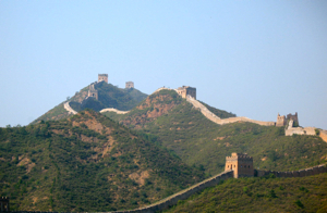 Great Wall of China snaking on the tops of the hills