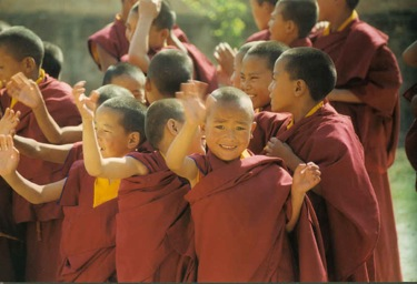 young boys, Tibetan monks waving