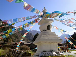 Tibetan stupa with prayer flags