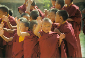 Tibetan Monks Waving young boys