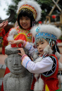 Yunnan Bai kids with fuzzy white hats