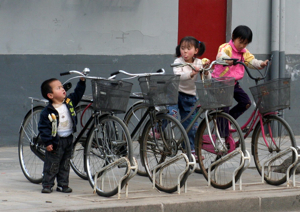 Kids China, playing with bikes