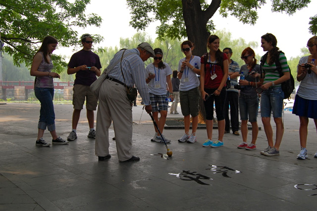 Students in China learning about calligraphy