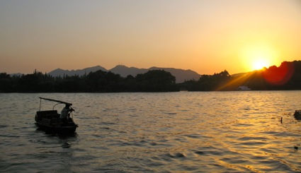 Hangzhou River with fisherman at sunset