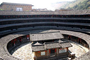 Round Hakka House, China, close up with another house in the middle